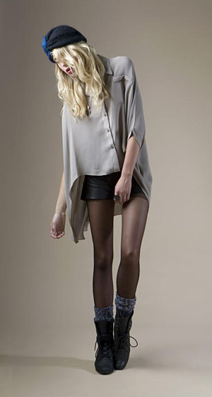 Silk tail cape top, $188; leather panel shorts, $216.
