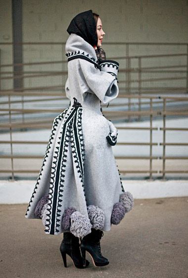 "An unidentified woman, shot in Paris, by <a href=""http://streetpeeper.com/fashion/huge-galliano-coat-paris"">Street Peeper</a>."