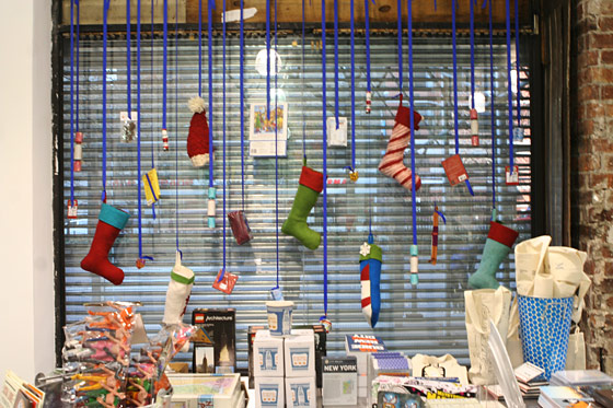 Knit stockings and hats hang from the walls.