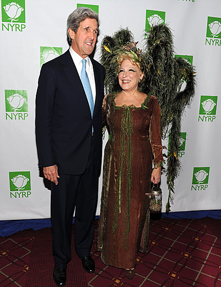 Martha Stewart made this costume for Bette, complete with fireflies. John Kerry is trying not to sneeze. Good thing he's her date — politicians are practiced at that sort of thing.