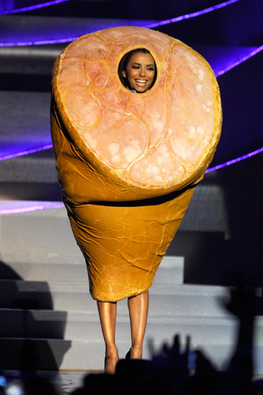 Eva hosted the awards show, changing ten times throughout the night. This ham costume is not only a strange and amusing way to pay homage to Madrid and Lady Gaga, but also a perfect representation of what it means to change outfits ten times in one night.