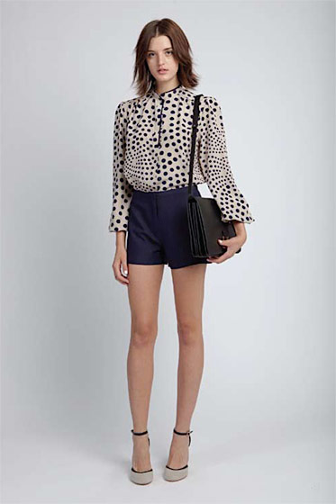 Mandarin-collar swing blouse, $280; high-waist short, $195; Mia shoulder bag, $420; covered wedge, $215.