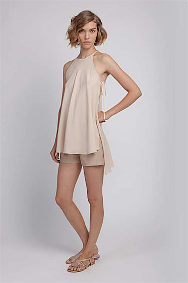 Asymmetric tunic, $235; high-waist short, $195; woven sandal, $255.