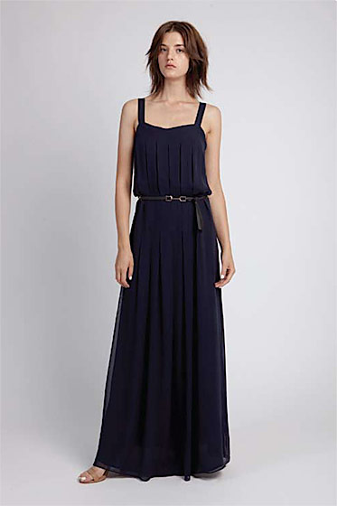 Box-pleated maxi dress, $420; multi-ring tie belt, $90; wide-strapped sandal, $245.