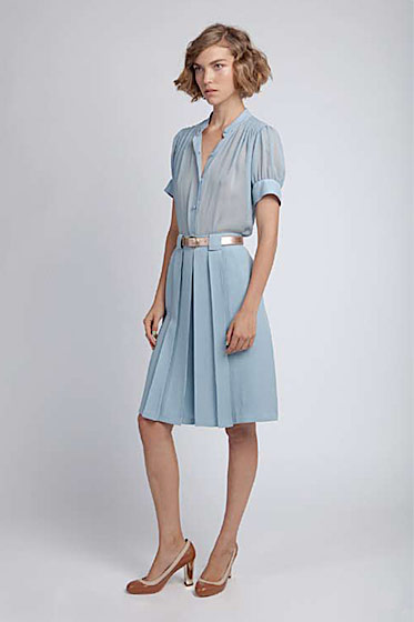 Short-sleeved smocked blouse, $150; box-pleated skirt, $265; skinny belt with pin buckle, $80; perforated pump, $245.