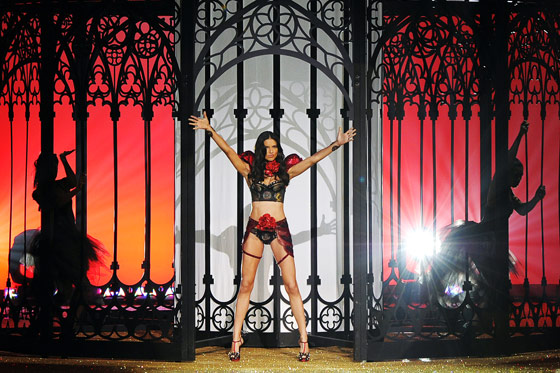 Adriana opened the show, her bosom bursting forth from a cage also housing dancing ballerinas. Her virtually no-carb diet and two-hour-a-day workout regime in the six weeks leading up to the show were visible in her rippling muscles.