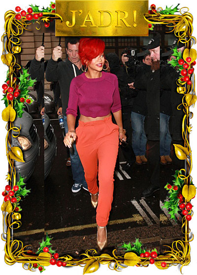 "Rihanna appeared on several ""best"" lists; Anna Dello Russo zeroed in on her outstanding color sense, as evidenced here by the combination of melon-colored Cacharel pants, a violet Maria Luisa top, and that fire-engine-red hair. [<a href=""http://www.annadellorusso.com/2010/12/10-best-dressed-of-year.html"">ADR</a>]"