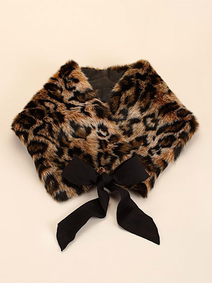 "Juicy Couture's leopard neck scarf, $75 <a href=""http://www.juicycouture.com/accessories/cold-weather/ytruc202/faux-fur-tippet"">online</a>."