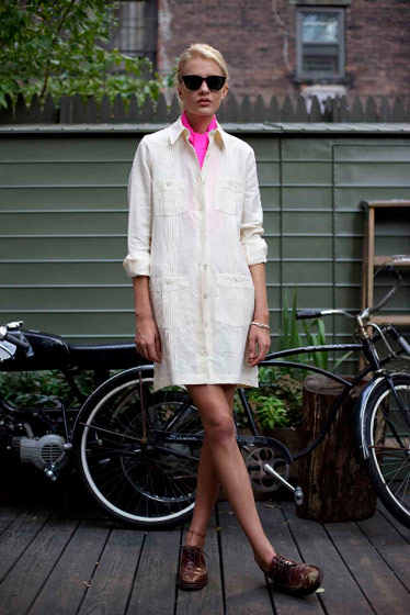 South of the Border dress in cream linen with mop buttons, $375; hot pink silk ascot, $75.