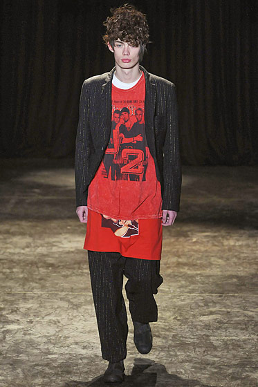 "See more from <a href=""http://nymag.com/fashion/fashionshows/2011/fall/main/europe/menrunway/commedesgarcons/"">Comme des Garcons' Fall 2011 Menswear Collection</a>."