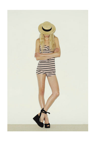 Striped playsuit, $79; straw hat, $59; wedges, $129.