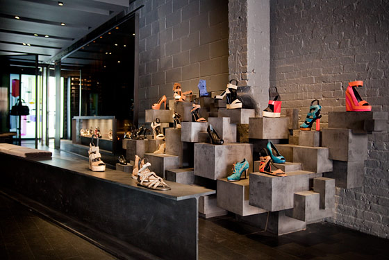 """At first glance, the shop might be the front office for an international weaponry brokerage, an illegal plastic surgery cult or perhaps an entertainment law office-slash-sex dungeon. The (presumed intentional) effect is to cause the shopper to question her own validity. Should she potentially corrupt the space inhabited by these rarefied shoes by insinuating herself into it, or should she should let all her credit cards slide from her fingers into the middle of West Fourth Street, lie down on them and succumb to a coma of existential ambivalence?"" </br></br>