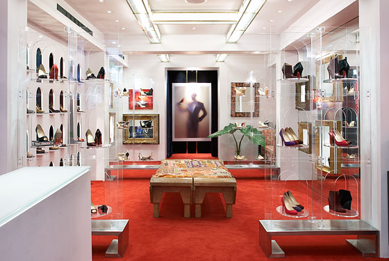 """Imagine the footwear wing of Frederick's of Hollywood, if it had tottered away to seduce the Wonka factory: wall-to-wall red carpet, mirrors, disco sequins and modular Lucite cubbies all showcasing a loopy series of variations on lickably shiny, nosebleed-high hooker pumps (the cheap American cousin of which is commonly known, in fetishistic eBay galleries, as 'the Pleaser')."" 