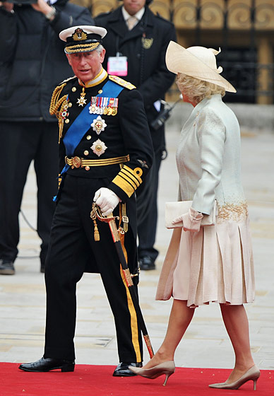 Camilla, Duchess of Cornwall, in a dress and coat by Anna Valentine, hat by Philip Treacy, and shoes by Jimmy Choo.