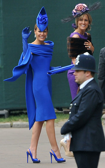 Tara Palmer-Tomkinson in a dress by Deborah Milner, shoes by Nicholas Kirkwood, and fascinator by Philip Treacy.