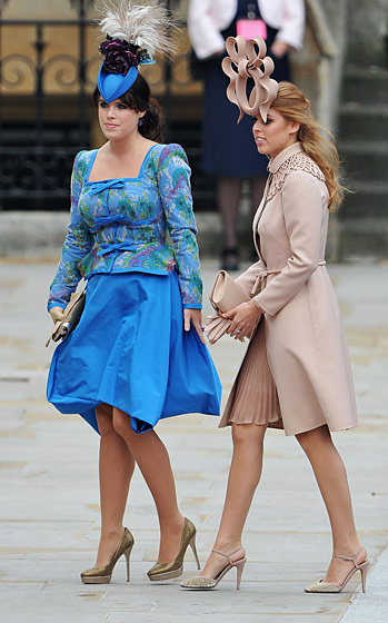 Princess Eugenie of York in a Vivienne Westwood dress and Philip Treacy hat; Princess Beatrice of York in Valentino haute couture and a Philip Treacy hat.