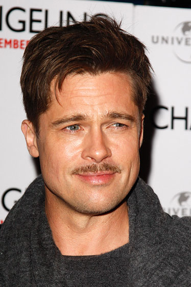 "Brad Pitt is the hottest man in the world, but he still feels like he has to prove it by walking around with an ugly, skinny mustache, because he knows it does not diminish said hotness one iota. ""My goal is to bring mustaches back,"" said the actor. Sigh. We'll just say what you want us to, Brad: <em>No one else will look as good with a rat tail on their face as you.</em>"