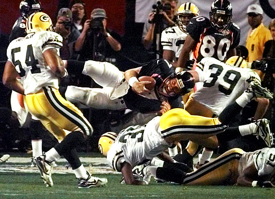 Super Bowl XXXII (Denver Broncos 31, Green Bay Packers 24): The pregame show is narrated by Phil Hartman in one of his final public appearances before being killed four months later. The Broncos become the first AFC team to win the Super Bowl in fourteen years thanks to the late-game heroics of John Elway (and the running of long-forgotten Terrell Davis).