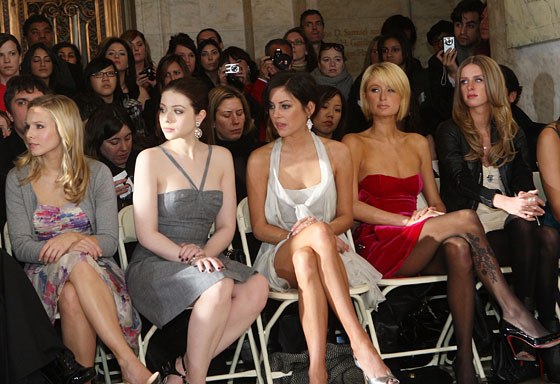 Jessica Stroup (center) is clearly as shocked as we are to see Georgina Sparks (Michelle Trachtenberg) consorting with Gossip Girl herself (Kristen Bell). The Hilton sisters are less enthralled.