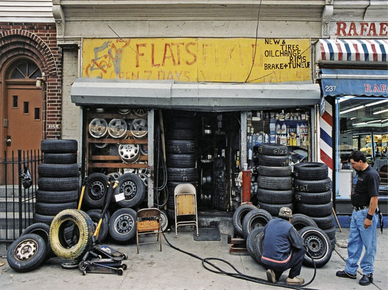 An outer-borough tire shop, just the kind of thing urban planners used to dream about expunging from the earth.