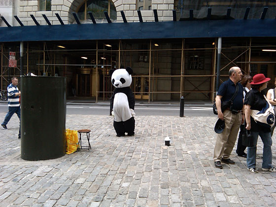 But the Sad Panda seemed to be reveling in his loneliness. Why else, we wondered, would he choose for his usual hangout the area around the Wall Street bull, where he would be inevitably shunned by tourists more interested in stroking the bull's brassy balls? Sadness for him wasn't just a look. It was a <em>lifestyle</em>.