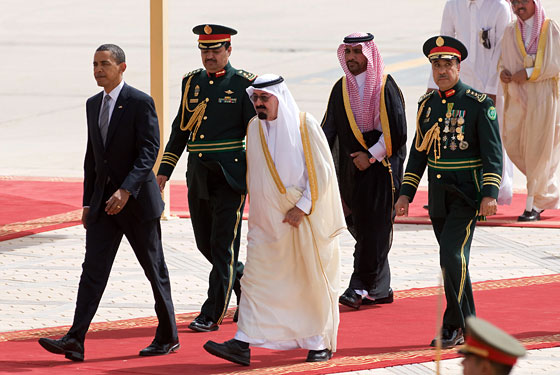 That general couldn't help but notice that next to Obama's well-tailored suit, Abdullah's robe looks a bit blousy. No judgment.