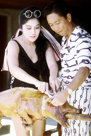 In 1972, the Philippine president and his wife showed the world that when poking out a roasted pig's brains, it was  it was best to wear scant clothing.