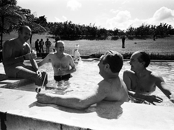 "French president Valery Giscard d'Estaing appears to be entertaining President Ford, Secretary of State Henry Kissinger, and French foreign minister Jean Sauvagnargues with the first ""That's how I know <em>you're</em> gay"" joke in Martinique in December 1975."