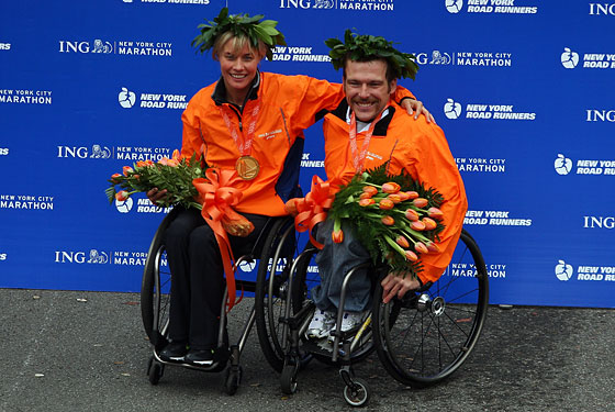 Edith Hunkeler of Switzerland and Kurt Fearnley of Australia celebrate together.
