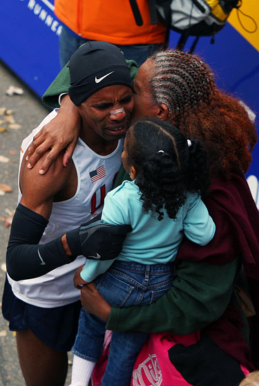 The winner celebrates with his family.