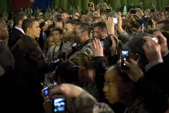Obama among the camera-wielding sea of troops.