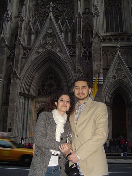 There is also a photo of the couple standing happily together in front of St. Patrick's Cathedral in New York.
