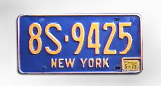 A completely new design: blue and gold, New York State's official colors. This is the first time plates aren't reissued every year — you replace just the sticker in that box down in the corner. EMPIRE STATE disappears. <br>