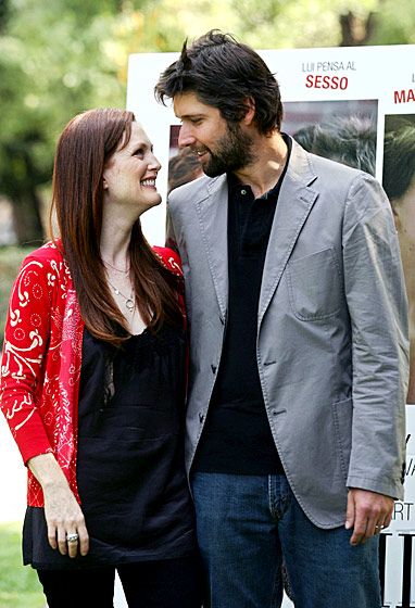 Everything about Julianne Moore gives us warm feelings, even her terrible Boston accent on <i>30 Rock</i>. Which is why we're rooting for her and her director husband, despite the fact that we've never watched a movie he's written or directed. If Julianne likes him (and look at that picture. She really, really does!), he has to be worth keeping.