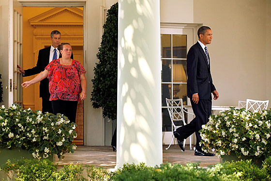 Secretary of Education Arne Duncan and an unidentified woman have been secretly following Obama around the White House for twelve minutes.