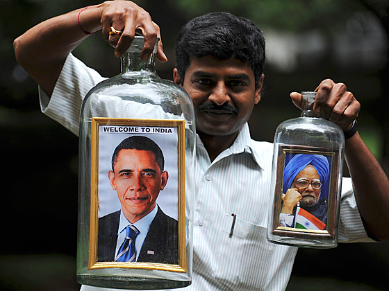 We have no idea how this man managed to get this framed photograph of Obama inside a glass jug, but it is certainly a more intensive process than anyone in America has been willing to undertake.
