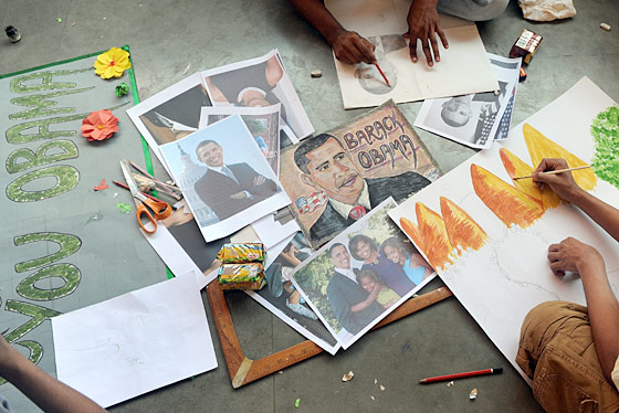 Mumbai street children have been mobilized in the hospitality effort, laboring for weeks to draw colorful and lifelike Obama welcome signs for three cents a day.