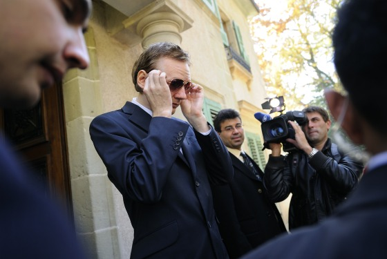 The man behind all this, WikiLeaks founder Julian Assange, adjusts his sunglasses as he leaves a press conference in Geneva earlier this month.