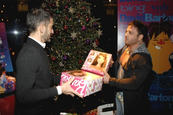 Marc Jacobs offers David Barton a Barbie for the toy drive. This should be someone's holiday greeting card.