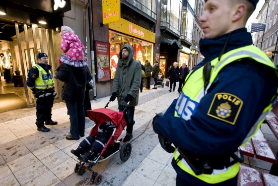 Cute Swedish policemen stand guard around Stockholm, a day after the scary incident.