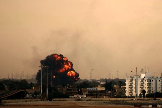 Smoke billows in Benghazi after a rebel airplane was shot down by the Libyan government yesterday.