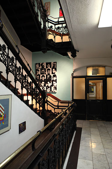 The famous wrought-iron staircase of the hotel has traditionally been adorned with art from its tenants, though now there are several blank spaces from when departing residents have taken theirs down.