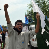 An activist in Pakistan protests at the U.S. embassy in Islamabad recently.