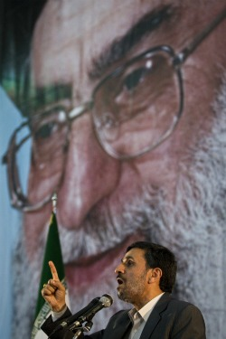 Ahmadinejad speaks before the looming visage of his greatest rival.